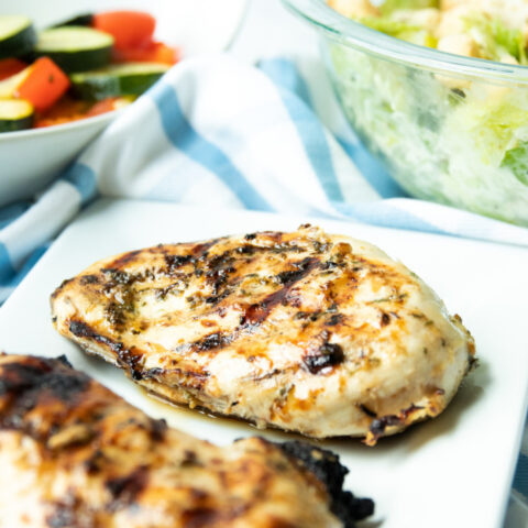 lemon garlic chicken on a plate with salad